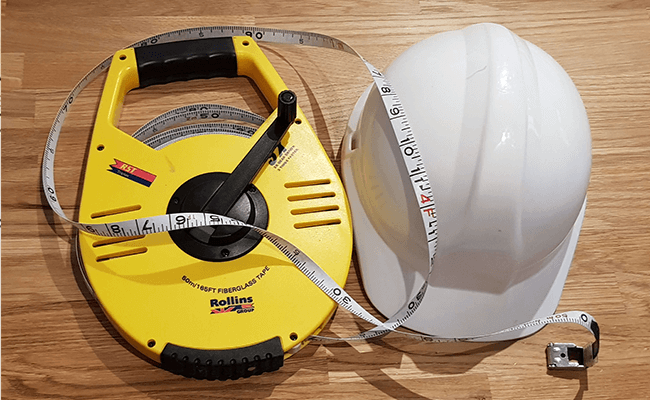 Surveyors-hardhat and measure